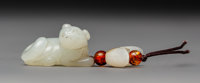 A Small Chinese White Jade Beast Form Toggle Strung with White Jade Tael 0-3/4 x 1-1/4 inches (1.9 x 3.2 cm)