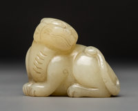 A Chinese White Jade Tiger Carving, Ming Dynasty or Later 2 x 2-1/2 inches (5.1 x