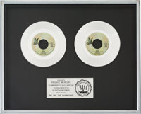 "Queen ""We Are the Champions"" RIAA Platinum Record Sales Award Presented to Freddie Mercury (Elektra)"