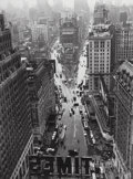 Photographs:Gelatin Silver, Lou Stoumen (American, 1917-1991). Times Square in the Rain,1940. Gelatin silver, printed later. 9 x 6-3/4 inches (22...