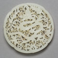 Jewelry, A Chinese Carved and Pierced Jade Dragon Plaque, Ming Dynasty. 1/4 x 3-1/2 inches (0.6 x 8.9 cm). ...