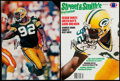 Autographs:Photos, Reggie White Signed Magazine Page Lot of 2....
