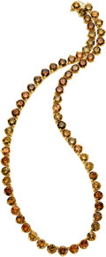 Estate Jewelry:Necklaces, Colored Diamond, Gold Necklace The necklace fe...