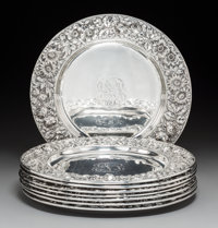 A Set of Eight Jenkins & Jenkins, Inc. Silver Repoussé Chargers, Baltimore, Maryland, 20th century Marks: JEN...