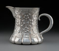 Silver & Vertu:Hollowware, A Tiffany & Co. Floral Repoussé Silver Water Pitcher with Elephant Foot Base, New York, 1892-1902. Marks: TIFFANY & CO, 85...