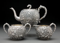 A Three-Piece Wang Hing Partial Gilt Repoussé Silver Tea Service, Hong Kong, late 19th-early 20th century Marks t...