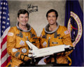 Explorers, John Young Signed Space Shuttle Columbia (STS-1) Orange Spacesuit Color Photo Directly the John W. Young Collection. ...