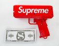 Collectible:Contemporary, Supreme X Cash Cannon. Money Gun, 2017. Painted cast resin, with Supreme $1000 bills. 6-1/2 x 7-1/2 x 3-1/2 inches (16.5...