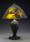 Lighting:Lamps, Pittsburgh Bronze and Reverse Painted Glass Call of the Wild Lamp. Circa 1920. Ht. 25 in.. ...