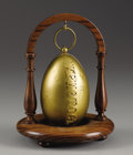 Decorative Arts, Continental:Other , Imperial Russian Gilt Metal Easter Egg. Third quarter of the19th century. Of typical form, hinged and fitted with pus...(Total: 2 Items)