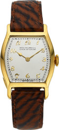 Timepieces:Wristwatch, Patek Philippe, Early Tonneau Gold Wristwatch, Circa 1925. ...