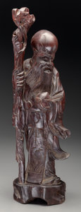 Carvings, A Carved Hardwood Figure of Shoulao, 20th century. 23-1/2 inches (59.7 cm). ...