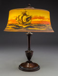 Lighting:Lamps, Pairpoint Bronze and Wood Base with American Reverse Painted Glass Nautical Shade. Circa 1920. Base stamped PAIRPO...