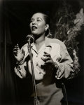 Photographs:Gelatin Silver, Herman Leonard (American, 1923-2010). Billie Holiday, New York City, 1949. Gelatin silver, printed later. 11-1/2 x 9-5/8...