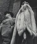 Photographs:Gelatin Silver, Leon Levinstein (American, 1908-1988). Man in Suit, Woman in Fur Coat, 1954. Gelatin silver, printed later. 17-5/8 x 15-...