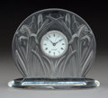 Glass, A Lalique Clear and Frosted Glass Iris Clock, post-1945. Marks: To clock face LALIQUE, SWISS; Engraved to ba...