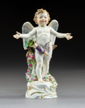 Ceramics & Porcelain, A Meissen Polychrome and Partial Gilt Porcelain Cupid Figure, Meissen, Germany, 20th century. Marks: (crossed swords in unde...