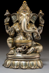 A Large Indian Partial Gilt Silver Alloy Seated Figure of Ganesha 9-7/8 x 5-1/2 x 4-1/4 inches (25.1 x 14.0 x 10.8