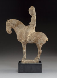A Chinese Siu Pottery Equestrian Figure, Sui/Tang Dynasty 14 x 8-3/4 x 3-1/2 inches (35.6 x 22.2 x 8.9 cm) (overal