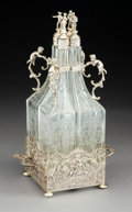 Silver & Vertu, A Five-Piece German Silver and Silver-Mounted and Etched Glass Decanter Set with Figural Stoppers, late 19th century . M...