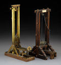 Decorative Arts, Continental, Two Continental Guillotine-Form Cigar Cutters, late 19thcentury-early 20th century . Marks to shorter: Guillotina SIGLOX... (Total: 2 Items)