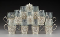 A Set of Silver and Glass Tumblers, early 20th century Marks: STERLING, 025 5-1/8 x 3 x 3 inches (13