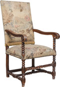 Furniture , A French Louis XIII-Style Carved Walnut Armchair with Tapestry Upholstery, 19th century. 48-1/4 x 25-1/4 x 29-1/4 inches (12...