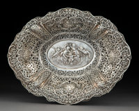 A German Reticulated Repoussé Silver Center Basket, post-1886 Marks: 800, 1, (crescent-crown) (partiall