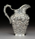 Silver & Vertu, A Baltimore Silversmiths Mfg. Co. Repoussé Silver Pitcher, Baltimore, Maryland, early 20th century. Marks: (B-lion's head-S)...