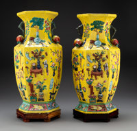 A Pair of Chinese Famille Jaune Enameled Porcelain Vases with Carved Wood Stands, 20th century 18-1/2 x 9-1/2 inch