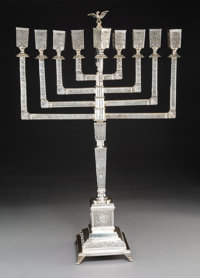 A Continental Silver Menorah, possibly Germany, early 20th century Marks: 800 29-5/8 x 193-3/4 inches (75.2 x 492.1 cm...