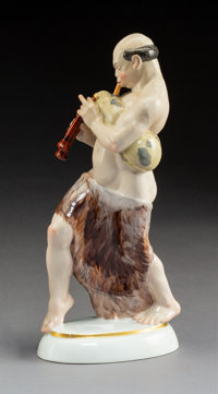 A KPM Polychromed Porcelain Arab with Bagpipe Figure Modeled by Adolph Amberg, Berlin, Germany, modeled 1913 Ma