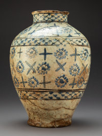 A Large Safavid Blue and White Glazed Pottery Jar, Persia, 16th-17th century 14-1/2 x 10 inches (36.8 x 25.4 cm)