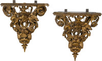 A Pair of French Carved Giltwood Figural Brackets, late 19th century 15 x 14 x 8 inches (38.1 x 35.6 x 20.3 cm)