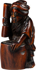 Carvings, A Japanese Carved Boxwood Figural Netsuke, Edo period. 2-1/8 x 0-7/8 x 1-1/4 inches (5.4 x 2.2 x 3.2 cm). ...