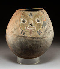 A Paracas-Ocucaje phase Ovoid Jar with Pair of Incised Felines c. 300-200 BC