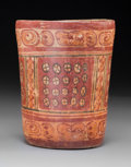 Pre-Columbian:Ceramics, A Maya Painted Cylinder with Glyphs...