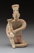 Pre-Columbian:Ceramics, A Jalisco Seated Musician Playing a Fish-Shaped Rasp