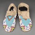 American Indian Art:Beadwork and Quillwork, A Pair of Sioux Beaded Hide Moccasins c. 1...