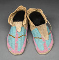 American Indian Art:Beadwork and Quillwork, A Pair of Sioux Beaded Hide Moccasins. c. 1910. ... (Total: 2 Items)