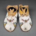 American Indian Art:Beadwork and Quillwork, A Pair of Cheyenne Beaded Hide Moccasins. c. 1900...