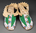 American Indian Art:Beadwork and Quillwork, A Pair of Sioux Beaded Hide Moccasins Prov...