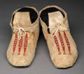 American Indian Art:Beadwork and Quillwork, A Pair of Plains Beaded Hide Moccasins... (Total: 2 Items)