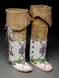 American Indian Art:Beadwork and Quillwork, A Pair of Sioux Child's Beaded Hide Leggings/ Moccasins. c. 1890... (Total: 3 Items)