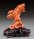 Carvings, A Chinese Coral Carp with Fitted Hardwood Stand. 5-1/4 x 4-5/8 x 3-1/8 inches (13.3 x 11.7 x 7.9 cm) (including stand). ...