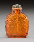 Carvings, A Chinese Amber Snuff Bottle with Jade-Inset Stopper, Qing Dynasty. 2-3/4 x 2 x 3/4 inches (7.0 x 5.1 x 1.9 cm). ...