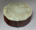 Carvings, A Chinese Carved White Jade Ruyi Head on Hardwood Box, Qing Dynasty, 19th century. 2-1/4 x 6 x 5-1/4 inches (5.7 x 15.2 x 13...