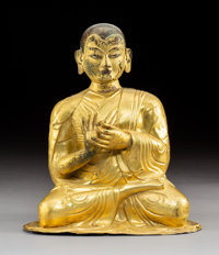 A Tibetan Gilt Bronze Repousse´ Lama Figure, 19th century 12-1/2 x 11 x 7-1/8 inches (31.8 x 27.9 x 18.1 cm)