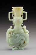Carvings, A Chinese Carved Celadon Jade Vase with Phoenix-Form Base, Qing Dynasty, 18th century. 7-1/2 x 4-1/8 x 1-1/4 inches (19.1 x ...