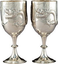 A Pair of Asian Hammered Silver Dragon Goblets, 20th century Marks: T.90</